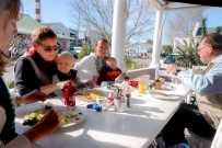 Y family lunch on stoep in the front